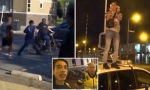 "Pic shows: man on bike was hit by the group; A group of young migrants have been terrorising a city neighbourhood and even taping some of their crimes on video, bragging about their behaviour and yet nothing has been done to punish them. The group of youngsters from the city of Zaandam in the Netherlands came to the attention of local media last week after repeated alleged incidents involving the intimidation of citizens, police officers, and even one incident captured on camera that involved them beating up a passer-by on a bicycle. Videos of the youngsters dancing on a police car have even appeared online, without them being apprehended for it. When the group of mostly Turkish migrants was invited to a primetime talk show, a nationwide debate was triggered as to how it was possible that such a group could continue to terrorise a town without any of the authorities tackling the issue. Ismail Ilgun presented himself as the spokesman of the group of youngsters on national television. His friends were seated behind him, refusing to take off their sunglasses. They blamed the national media for stigmatising them and told the TV programme they only hung around the streets because the city council did not give them a youth centre. Cinderella Meijer, who works at a youth centre, explained that the group was already booted out after damaging and stealing from it. She said: ""This has already been playing out for ten years. They get everything from the city council, everything is done. But each time they destroy the property and steal. They even threatened us with a firearm when we tried to stop them from smoking inside."" Even Dutch PM Mark Rutte, 49, felt the need to respond to the local crisis in Zaandam. He said: ""They are the scum of the earth. The police and local authorities are right on it. ""They should just buzz off,"" he added. Yet local politicians did not seem to have taken note of the Dutch Prime MinisterÌs words. On Monday, one of the few critical members of the city council of Zaandam, Juliette Rot, was allegedly threatened by the migrant group in front of her house. She said: ""They jumped out of a car and started to tape and intimidate me. Ilgun blamed me, saying I was stigmatising them. He stood right in front of me in a very threatening way. From the car they shouted something like Îwe know where to find youÌ."" Rot has been raising the issue for months, and as a result is the frequent target of abuse from the group. She said her house had been bombarded with eggs and at times they were waiting for her on the pavement in front of her house. Rot said: ""After the last incident I still did not hear anything from the mayor."" Some of RotÌs colleagues even seemed to take the side of the migrant group. Local Socialist Party leader Patrick Zoomermeijer even said the youngsters were ""unpolished diamonds"". In his latest video, Ismail Ilgun said: ""Who the f**k are all you racists? I am an Erdogan warrior, a Turk who will remain in the Netherlands and who will earn a lot of money by making videos without working for it."""